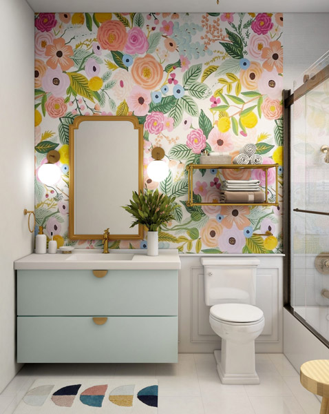 bathroom renovation designed with bright color, floral motifs and glass shower door